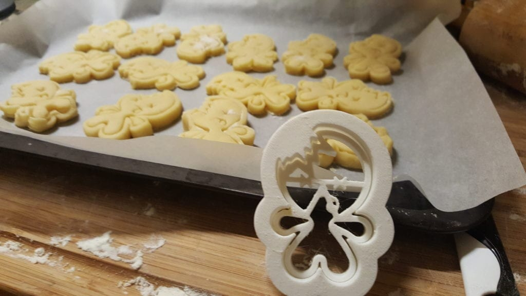 cookie cutter halloween zombie cute gingerbread man in fron tof tray of cookies