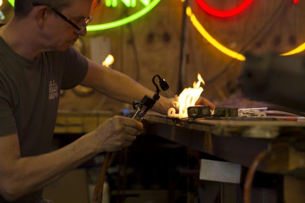 Ciaran Larkin BL Neon blowing glass neon with a flame